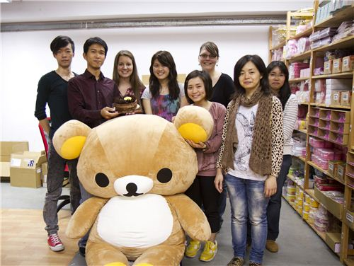 Our team including office mascot Rilakkuma with the cake - if you can find it