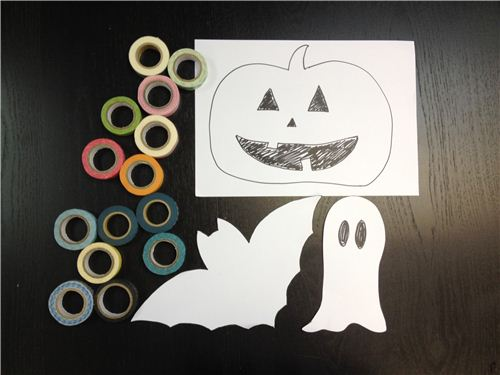 You need: Washi Tapes, Halloween designs, cooking paper, a pen and a pair of scissors