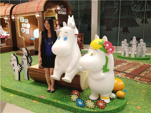 People loved to get their picture taken with the cute Moomin hippos
