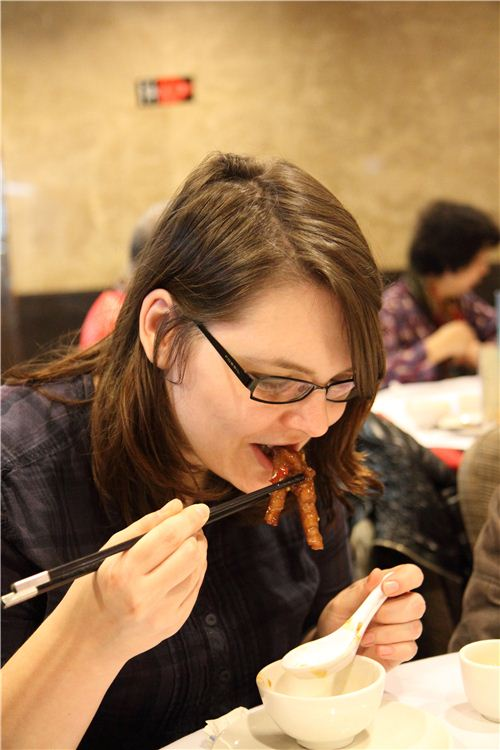 Bianca kept her promise and tries chicken feet - yummy