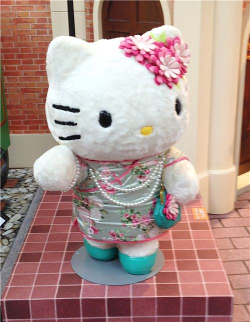 Hello Kitty as a nice lady from the 60s