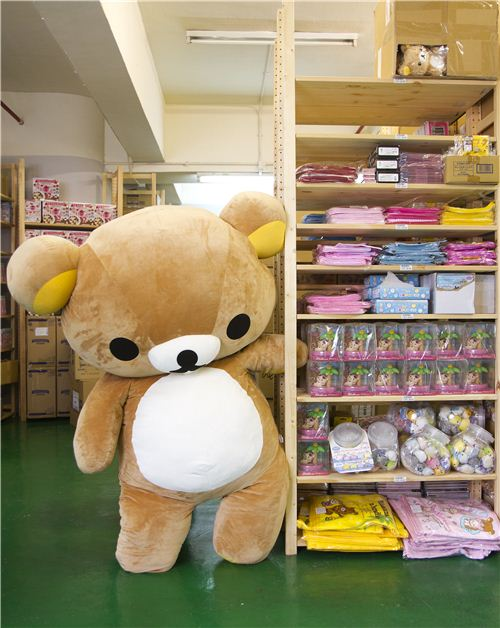 Our office mascot taking a look at products from the ALoha Rilakkuma collection