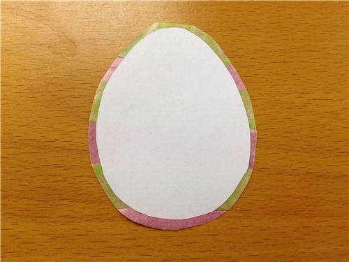Cut out the eggs and leave a little tape border