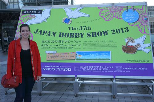 Sandra next to the official poster of the Japan Hobby Show 2013