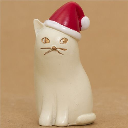 cute white cat with red Santa Claus hat from Japan
