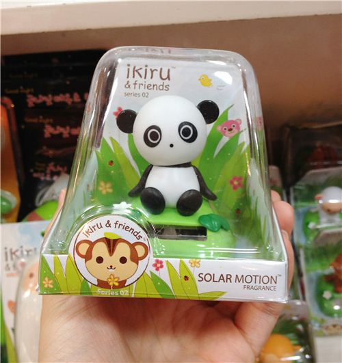A super cute solar panda that moves his head